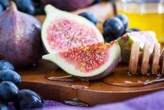 Fresh figs and dark grape Stock Photos