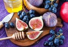 Fresh figs and dark grape Stock Photo