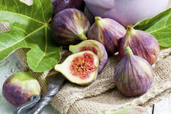 Fresh figs, Ficus carica, old knife on sackcloth Royalty Free Stock Photography