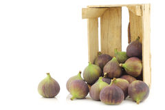 Fresh figs (Ficus carica) in a wooden crate Royalty Free Stock Images