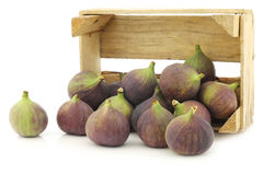 Fresh figs (Ficus carica) in a wooden crate Royalty Free Stock Image