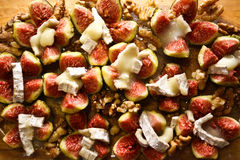 Fresh figs with goat cheese and walnuts Stock Images