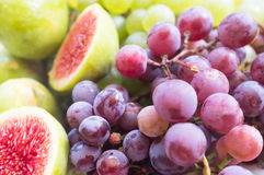Fresh figs and grape Stock Images