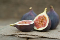 Fresh figs on hessian napkins on wooden background Stock Photo