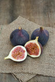 Fresh figs on hessian napkins on wooden background Stock Images