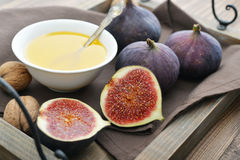 Fresh figs with honey and nuts Royalty Free Stock Photo