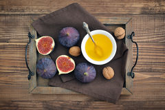Fresh figs with honey and nuts Stock Image