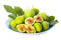 Fresh figs with its leaves isolated on a white background royalty free stock photo