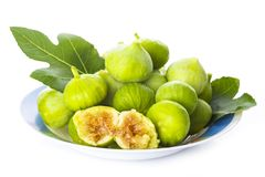 Fresh figs with its leaves isolated on a white background stock images