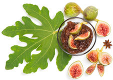 Fresh figs with leaves and fig jam  in bowl, top view Stock Photo