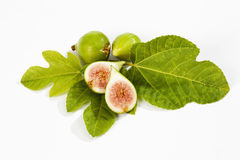 Fresh figs with leaves on white background Stock Photos