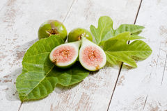 Fresh figs with leaves on white wood Stock Images