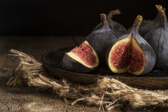 Fresh figs in moody natural lighting set with vintage retro styl. Fresh figs in moody natural lighting set with vintage style Royalty Free Stock Photo