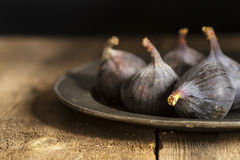 Fresh figs in moody natural lighting set with vintage retro styl Stock Photography