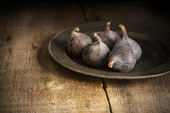 Fresh figs in moody natural lighting set with vintage retro styl Royalty Free Stock Photography