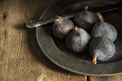 Fresh figs in moody natural lighting set with vintage retro styl Stock Photo