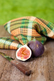 Fresh figs, old knife and chequered towel Stock Images