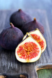 Fresh figs. On painted board Royalty Free Stock Photos
