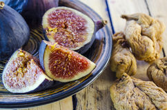 Fresh figs on a plate. Fresh figs in a bowl on a wooden table Stock Photos
