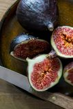 Fresh Figs on a plate. In the morning light Stock Photos