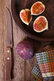 Fresh figs in a plate, old knife and towel Stock Photography