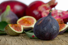 Fresh figs and pomegranate. Ripen fresh figs and pomegranate Royalty Free Stock Images
