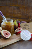 Fresh Figs and Preserve on Wood Table Royalty Free Stock Photos