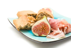 Fresh figs; Prosciutto and broken pieces of granar Royalty Free Stock Images