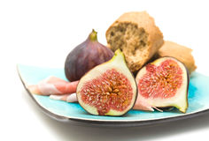 Fresh figs; Prosciutto and broken pieces of granar Royalty Free Stock Photography