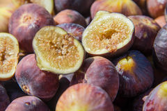Fresh figs. Fresh ripe purple figs in the sun stock photography