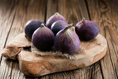 Fresh figs on rustic vintage wooden table. stock photography