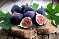 Fresh figs on rustic vintage wooden table. stock photo