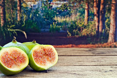 Fresh figs on rustic wooden table Stock Photography
