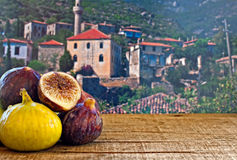 Fresh figs on rustic wooden table Stock Photo