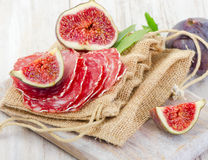 Fresh figs and salami Royalty Free Stock Photo