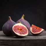 Fresh figs with slices. On a black background Royalty Free Stock Photography