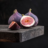 Fresh figs with slices. On a black background Royalty Free Stock Photo