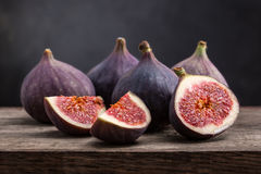 Fresh figs with slices. On a black background Stock Images