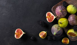 Fresh figs with slices. On a black background. top view Stock Images