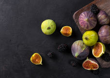 Fresh figs with slices. On a black background. top view Royalty Free Stock Images