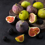 Fresh figs with slices. On a black background. top view Royalty Free Stock Photo