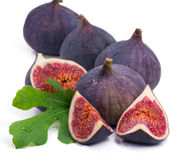 Fresh figs. Some fresh,juicy figs with green leaves Royalty Free Stock Image