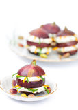 Fresh figs stuffed with soft cheese cream with dried orange peel Stock Image