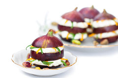 Fresh figs stuffed with soft cheese cream with dried orange peel Stock Photography