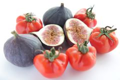 Fresh figs and tomatoes for salad on white backgro Stock Photo
