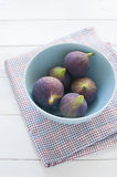 Fresh figs in turquoise bowl. On tablecloth Royalty Free Stock Photos