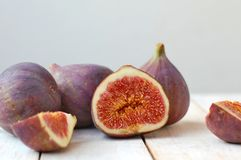 Fresh figs on white wooden background Stock Photography