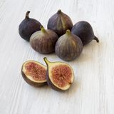 Fresh figs on white wooden background, side view. Closeup. royalty free stock images