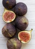 Fresh figs on white wooden table, overhead view. From above, flat lay. Close-up stock image