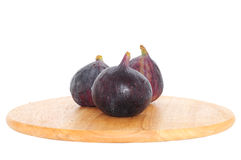 Fresh figs on wooden board Royalty Free Stock Photos
